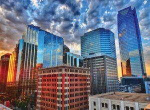 oklahoma city downtown skyline at sunrise, clouds and sunlight reflecting off of buildings
