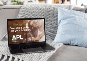 APL Logo on laptop screen design by Hester Designs