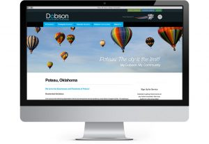 iMac computer displaying Dobson Technologies communities page