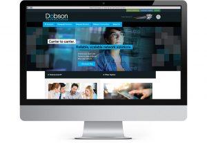 iMac computer displaying Dobson Technologies home page