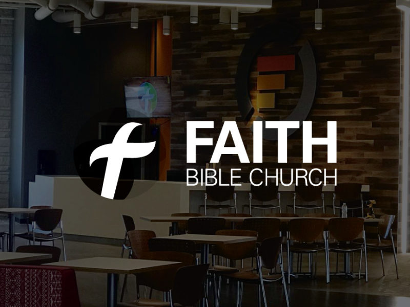 Edmond Faith Bible Church Logo over darkened background photo of wall art designed by Hester Designs