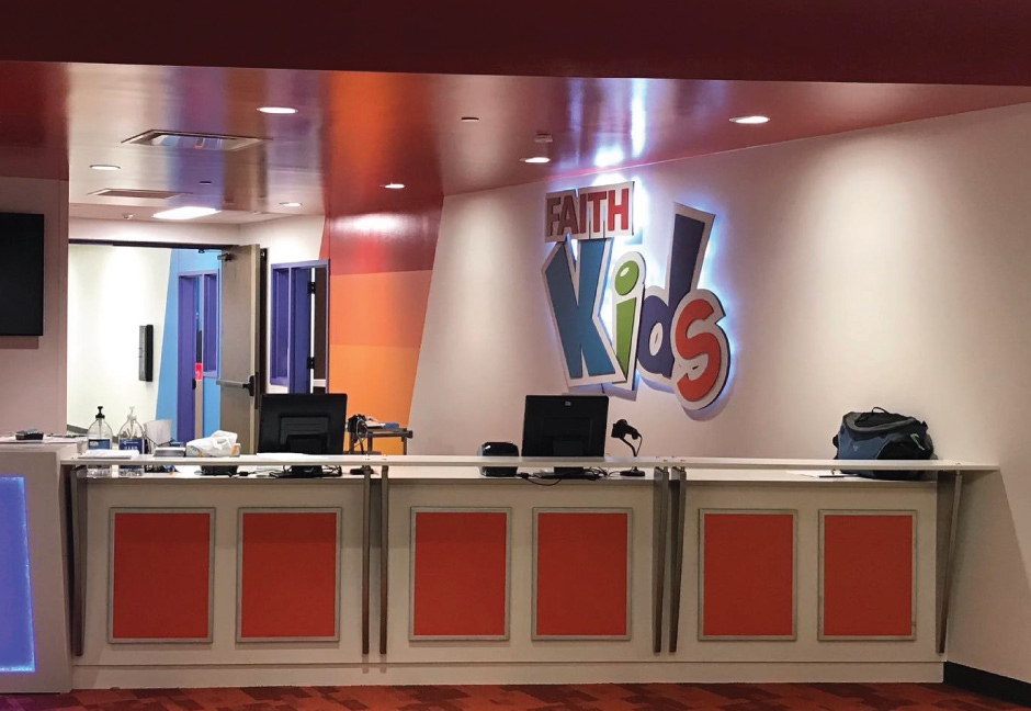 Faith Kids signage and new interior colors in new dedicated space