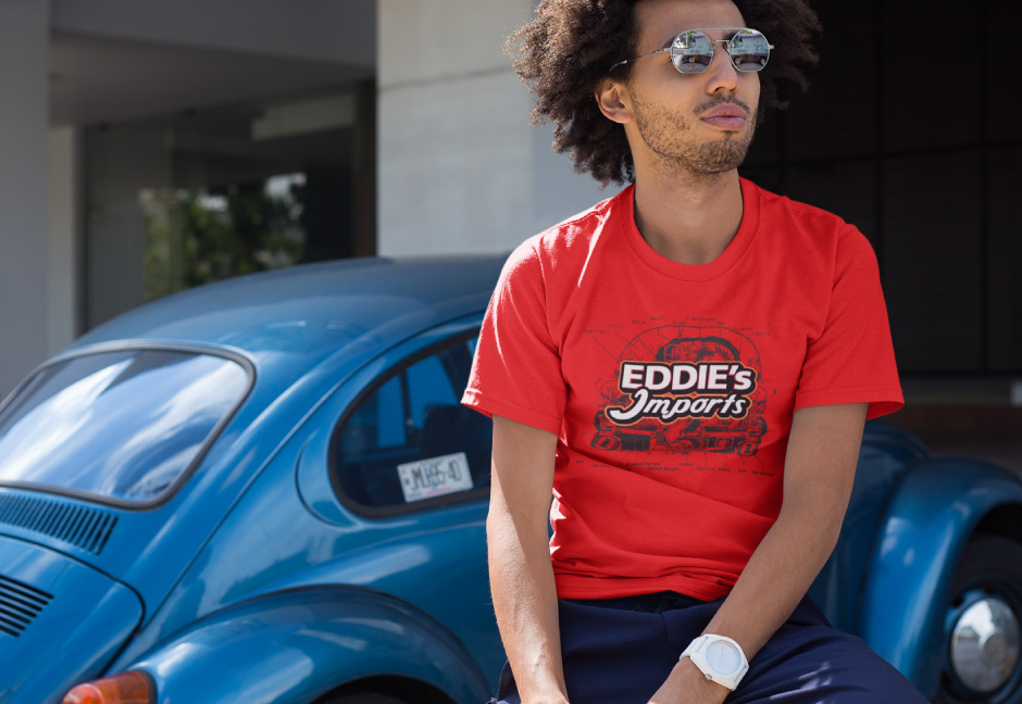 eddie's import logo on t-shirt mockup being worn by cool looking male with sunglasses