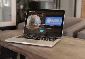 Global Land Partners website displayed on laptop on desk