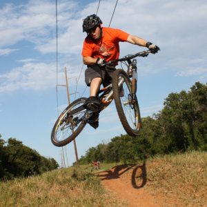 Jeff Hester jumps his mountain bike at Draper Lake trails in Oklahoma