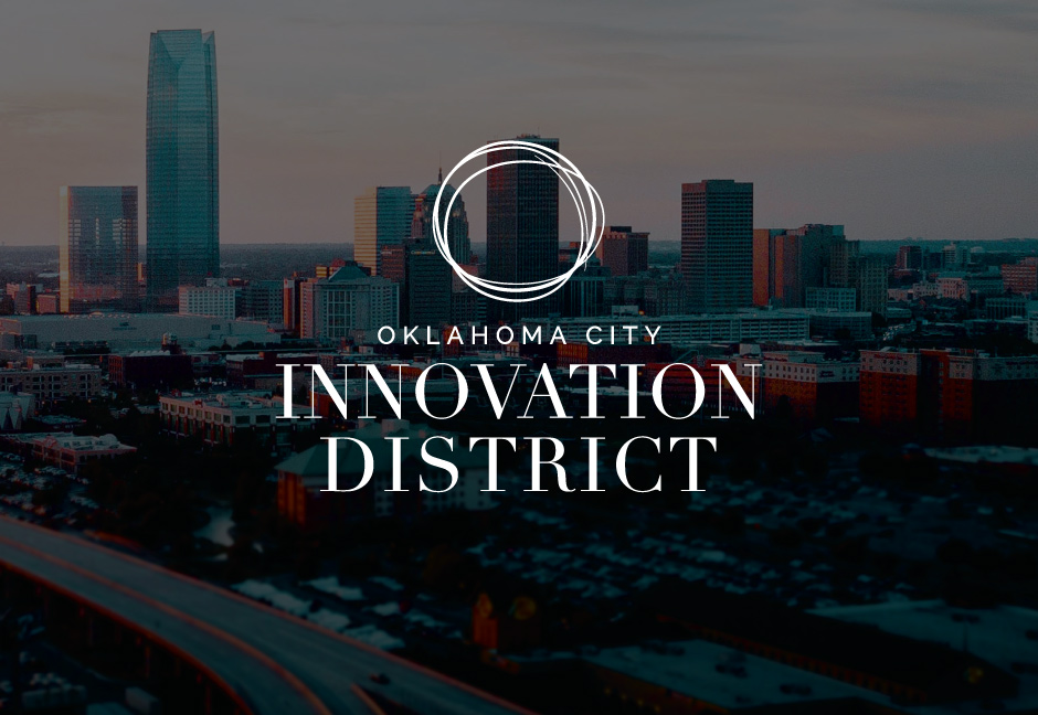 Oklahoma City Innovation District Logo over darkened background image of Oklahoma City skyline
