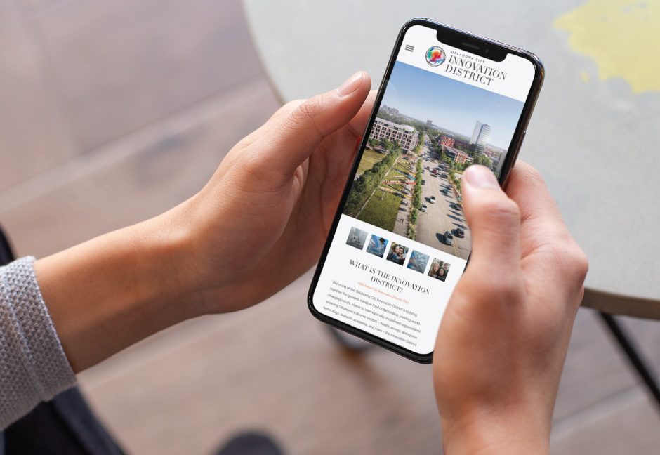 Oklahoma City Innovation District website by Hester Designs displayed on iPhone X screen