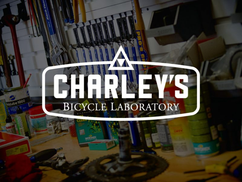 decorative background with charley's bicycle laboratory logo foregound