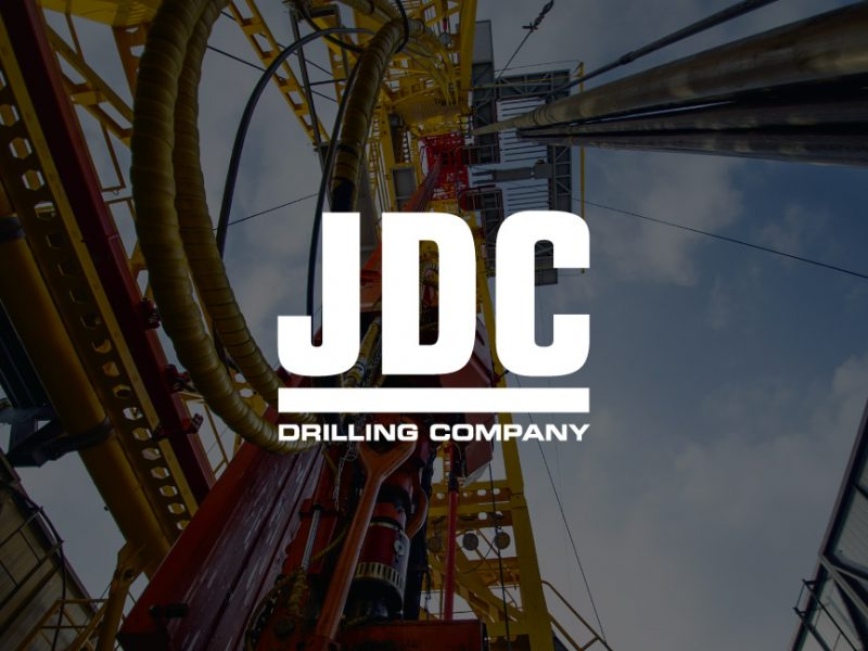 decorative background with JDC Drilling logo foregound