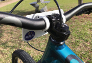 A bicycle handlebar with plate mounts installed rider side view