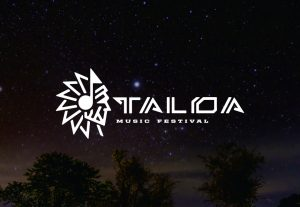 decorative background with tall music festival logo foregound