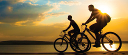 Two cyclists enjoying a bike ride at sunset