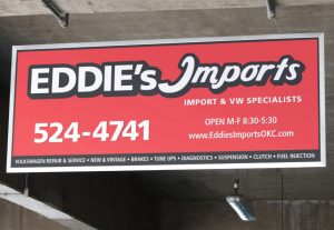 Eddie's Import sign mockup in use