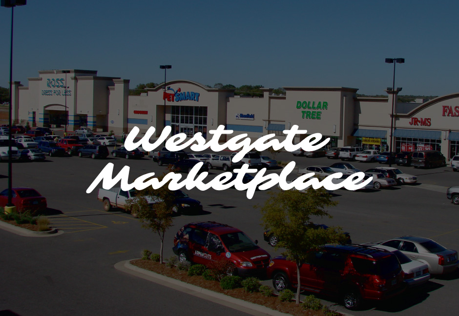Westgate Marketplace logo with decorative background