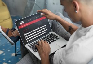 Young man filling out job application form on JDC Drilling website
